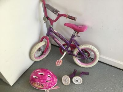"12"" girls Huffy with training wheels and a helmet"