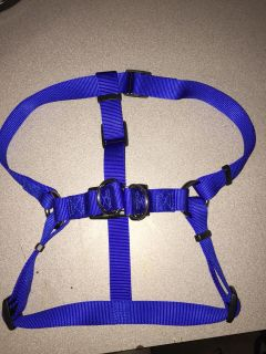 Easy step in size large dog harness that can possibly fit xl. 1 thick. Good for up to 75 . Porch pick up near White House middle school.