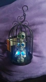 NWTSpooky metal light up skulls in cage hanging/or table top decor