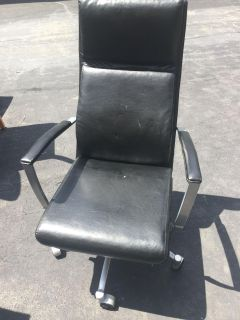 Leather computer chair with high back.