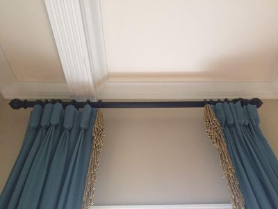 Blue goblet pleated draperies with bouillon trim