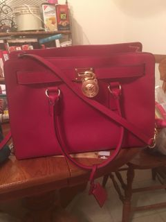 Red Michael Kors leather purse