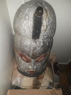 Wooden mask with tin plating