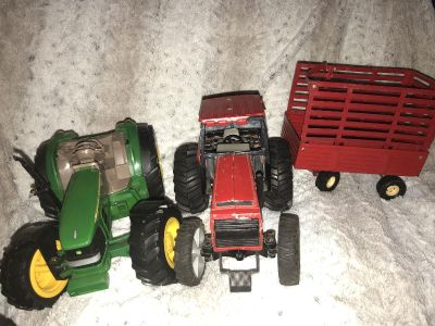 Two tractors-1 plastic and 1 metal with trailer $5 for both