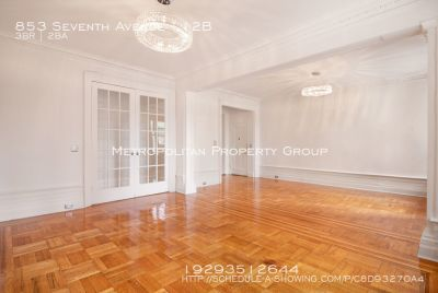 No Fee~ natural light from multiple exposures, and original wood floors with custom inlay detail. Approximately 1,700 SF, three large bedrooms, two large full bathrooms.