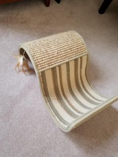 Cat scratcher with feather
