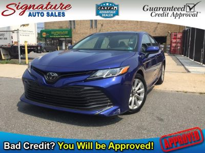 2018 Toyota Camry LE Auto (Natl) (Blue Crush Metallic)
