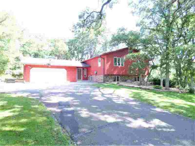 462 Frontage Road HUDSON Four BR, Tucked in the woods and