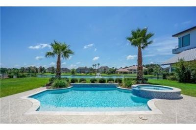 Spectacular lake views from resort-like custom home in gated community.
