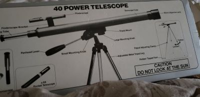 Telescope with metal tripod