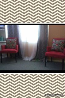 2 red microfiber arm chairs