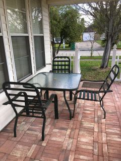 Glass patio table with 3 chairs