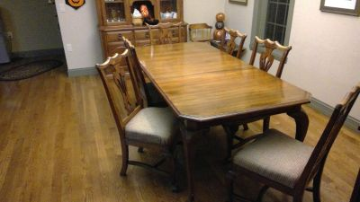 Wooden dining room table with china hutch