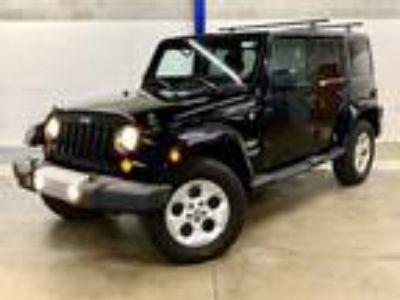 2013 Jeep Wrangler Unlimited Sahara 3.6L V6 285hp 260ft. lbs.