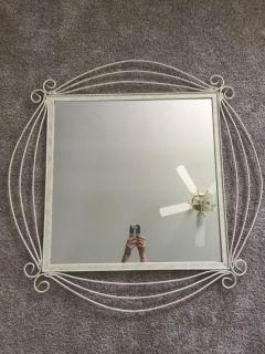 Mirror with unique metal frame