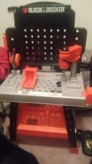 Black n decker kids tool bench..with attached working saw and drill ..nails ..