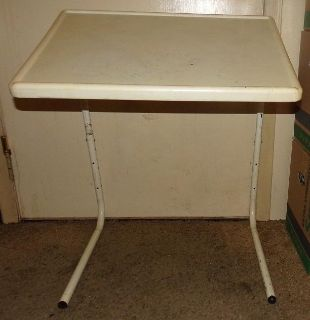Folding Table Adjustable Tray has some rust on legs have picture of it folded up in comments