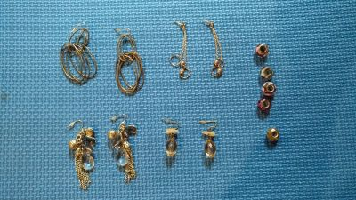 Free 4 Pairs of Earrings and Few Charms for Bracelet