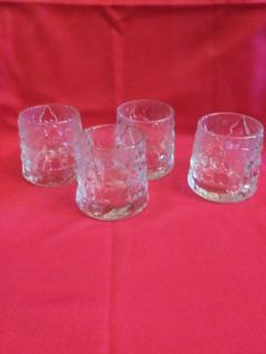 4 Votive candle holders.