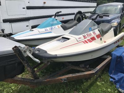 Three jet skis with trailer and box..
