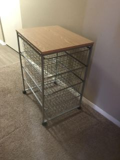 Table-cart on wheels w/ metal drawers. Dek/syc delivery