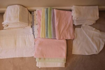 Huge lot of receiving blankets and burp cloths