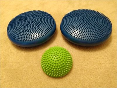 2 ifit dual sided Inflated Stability Wobble Cushions and 1 small Gaiam sensory ball
