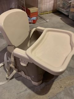 Dinner time booster seat with tray