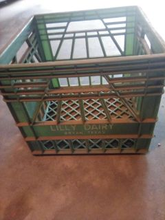 """Green plastic crate. Lilly Dairy, Bryan, Texas. 13"""" x 1 3"""" x 1 1"""" deep. Good condition but needs to be cleaned.."""