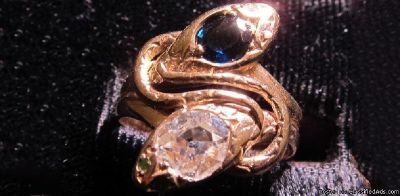 Double Snake Engagement Ring with a Diamond & Sapphire from Beverley R