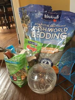 Hamster necessities - food, bedding, wheel, snack rings, mineral roller