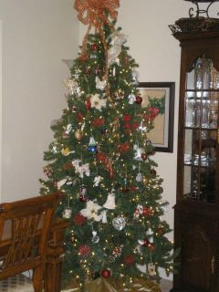 7.5 ft Christmas tree. Prelit Christmas Tree. Used a couple seasons. Worked perfectly when stored. Sam s Club. Selling due to downsized home