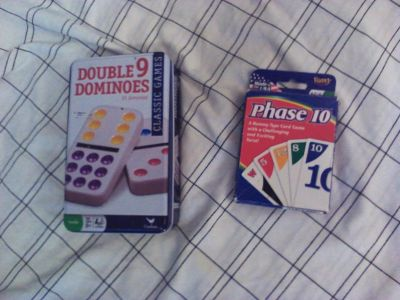 Double 9 Dominoes game in tin container. And Phase 10 card game. Lot of 2 games for $7