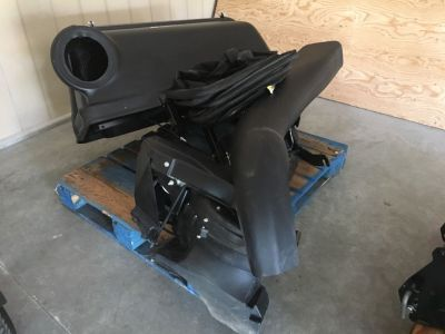 John Deere mowing bagger attachment