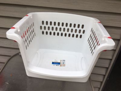 1 white plastic stackable crate