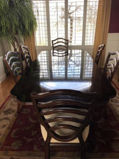 Solid wood dining room table, hutch, 6 chairs, and hand tufted rug
