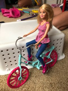 Barbie with bicycle