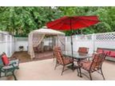 Roommate wanted to share Four BR Two BA Townhouse...