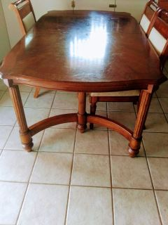 Solid wood oak table with leaf and 3 chairs