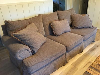 Couch and oversized chair with ottoman