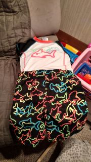 Shark bathing suit with matching rash guard.