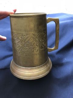 Brass cup made in India. $5.00