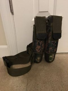 2 paint ball canisters with holster