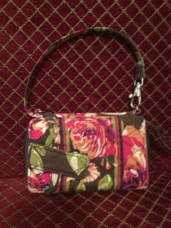 Vera Bradley Wristlet. Zipper opening holds ID, credit cards, and cash. Outside has snap to hold cell phone.
