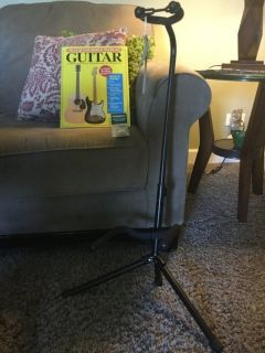 New guitar stand with book and 12 pics