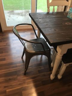 Two metal chairs used at the end of our table
