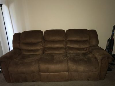 Like new reclining sofa and love seat