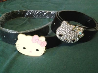 $15, hello kitty belt buckles and jeans size 34
