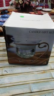 Brand new glass candle holder. $3