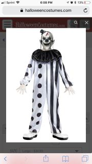 Kids size large 12-14 spirit Halloween killer clown costume. Comes with suit and face mask only. No holds.